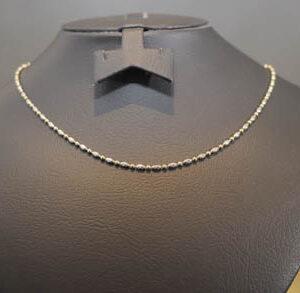 Hvidguld og guld halskæde i 18 karat guld